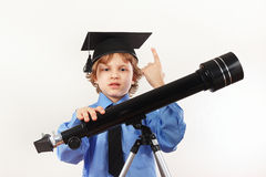 Little professor in academic hat with old telescope on white background Stock Image