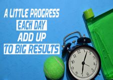 A little Progress each day add up to big results. Fitness motivation quotes. Sport concept stock photography