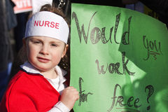 Little protester. 2011/2/16:The Irish Nurses and Midwives Organisation has warned that student nurses who face pay cuts could harness a block of 200,000 votes stock image