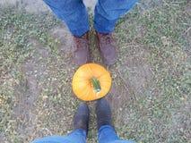 Little pumpkin, big feet Stock Image