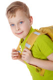 Little pupil. Portrait of a boy with satchel Royalty Free Stock Photo