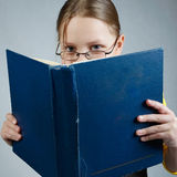 Little pupil  girl with books Royalty Free Stock Photos