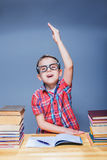 Little pupil pulls a hand up in the classroom Stock Images