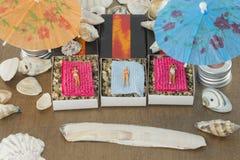 Little puppet figures on the beach stock photo