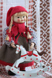 Little puppet with rocking horse. Little puppets in national traditional folklore dress Finland standing beside rocking horse royalty free stock image
