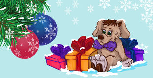 Little puppy with gifts in the snow Stock Photo
