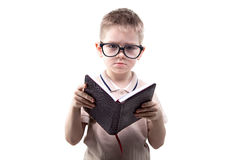 Little puzzled boy reading book Royalty Free Stock Images
