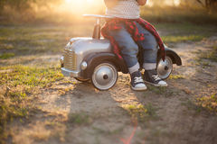Little racer and tiny car Stock Photography