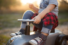 Little racer and tiny car Royalty Free Stock Image