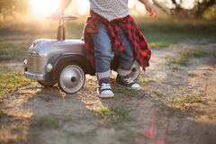 Little racer and tiny car Stock Image