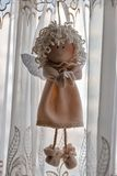 Little rag interior doll closeup. Little rag interior doll angel closeup against the window royalty free stock image