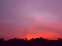 Little Rainbow, sunrise sunset times. Multicolour rainbow on the pink sky. With red orange sunset. Abstract rainbow sky, sunrise today, sunset time today royalty free stock images