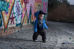 Little rapper. With money in a deserted place Stock Photos