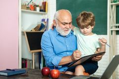 Little ready to study. Grandfather and grandson. Grandfather and grandchild. Teachers day. Concept of education and