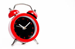 Little red alarm clock isolated  on  white background with copy Royalty Free Stock Photo