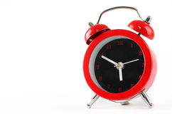Little red alarm clock isolated  on  white background with copy Stock Photography