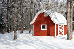 Little red barn in the winter stock images