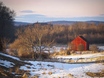 Little Red Barn in Winter. An old red wooden barn sits in in a snowy field in the Hudson Valley of New York State Royalty Free Stock Images