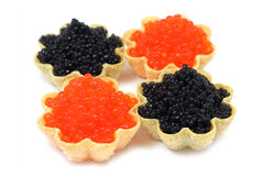 A little red and black caviar in tartlets Royalty Free Stock Photography