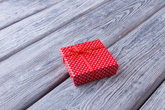 Little red box with a gift. Royalty Free Stock Images