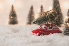 Little red car toy carrying Christmas tree royalty free stock photos