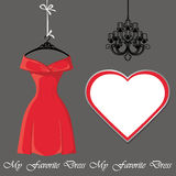 Little red dress with label and chandelier Stock Photos