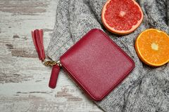 Little red female purse and citrus on a sweater stock photos
