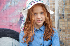 Little red-haired girl stock images