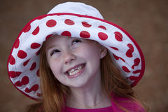 Little red haired girl in hat Stock Images