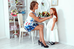 Little red haired girl and her mother Stock Images