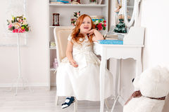Little red haired girl in white dress Royalty Free Stock Photo