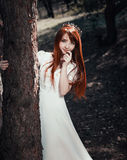 The little red-haired girl stock photo