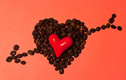 Little red heart with coffee beans. Little red heart in big coffee heart with arrow Royalty Free Stock Photography