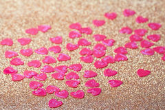 Little red hearts. On golden glitter background Royalty Free Stock Image