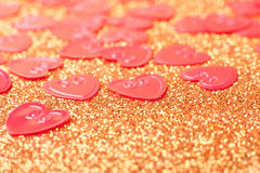 Little red hearts. On golden glitter background Stock Photography