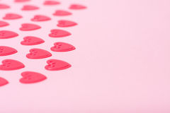 Little red hearts. On pink background Royalty Free Stock Photos