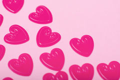 Little red hearts. On pink background Royalty Free Stock Photography