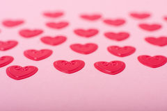 Little red hearts. On pink background Stock Photography