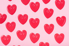 Little red hearts. On pink background Royalty Free Stock Photo