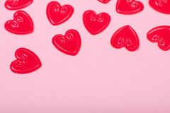 Little red hearts. On pink background Royalty Free Stock Image