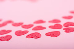 Little red hearts. On pink background Stock Photos