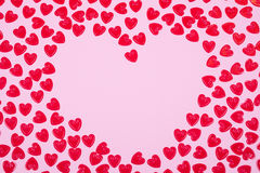 Little red hearts. Shape big one on pink background Royalty Free Stock Photos