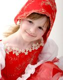 Little red hood. Portrait little girl in dress of red hood with small basket Royalty Free Stock Photography
