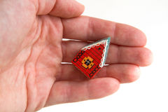 Little red house in a hand royalty free stock photography