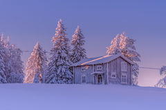 The little red house. A sunny but Cold winterday in Sweden Royalty Free Stock Photos