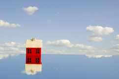 Little red house symbol on mirror Stock Image