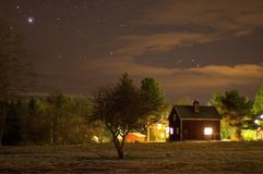 A little red house under a sky with stars. Night photography. Little red house under sky stars night photography universe astronomy galaxy milky way dark stock photo