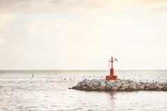 Little red lighthouse on the rocks Royalty Free Stock Photography