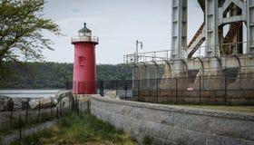 Little red lighthouse under Washington Bridge on overcast day royalty free stock image