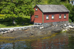 Little red norwegian hut on hardangerfjord Royalty Free Stock Photo